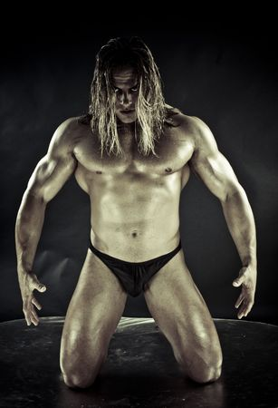 Dramatic image of a beautifully sculpted bodybuilder photo
