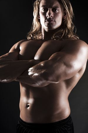 sixpack: Athletic sexy male body builder with the blonde long hair. gladiator
