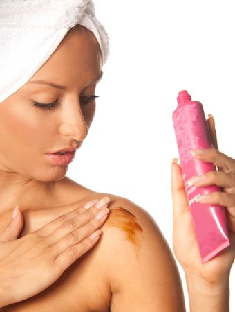 fake: Woman applying fake tan on her skin after shower Stock Photo