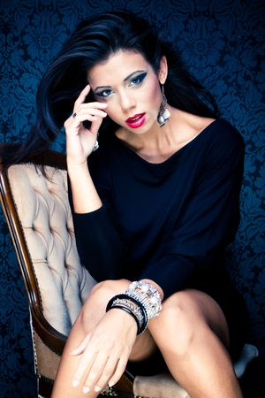 Vogue style vintage portrait of brunette model sitting on a chair  Stock Photo - 8042051