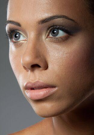 Beautiful woman face close-up photo