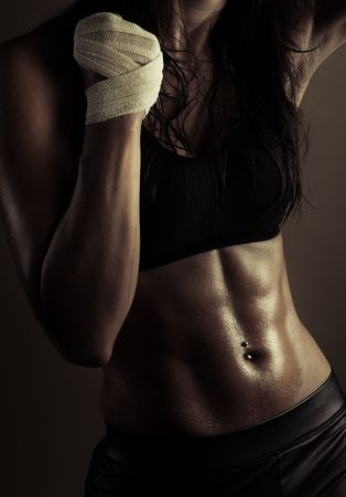 muscle girl: ideal sexy fitness body sweating  Stock Photo