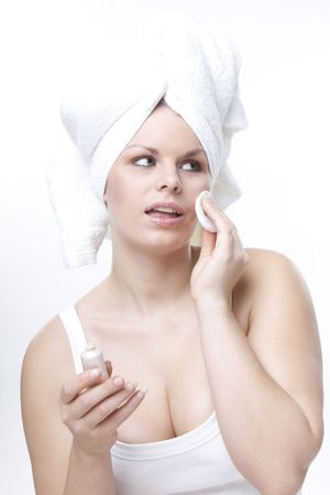 young beautiful woman cleaning face weraring a white towel on head Stock Photo - 8042038