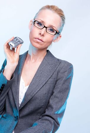 businesswoman wearing glasses using holding a phone  photo