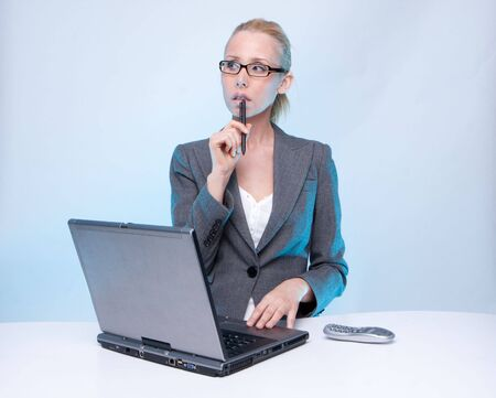 businesswoman using laptop computer and mobile phone photo