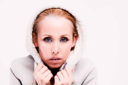 swarthy: Blond swarthy woman wearing white fleece hoodie posing at studio