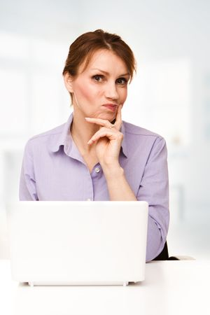 Beautiful businesswoman in her office using laptop