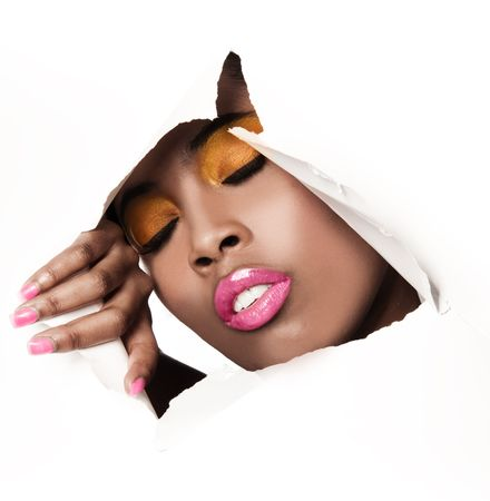 gloss: African woman with pink and yellow metallic make-up and full shiny lips - on the paper whole background  Stock Photo