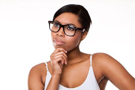 Black woman thinking wearing glasses on white Stock Photo - 8269451