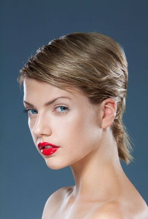 young beautiful female teenager with creative short hairstyle blue eyes and red lips  Stock Photo - 8269456