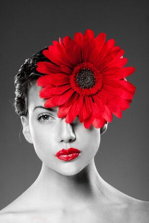 black and white portrait of woman with red lips and red flower on her face. Stock Photo - 8269458