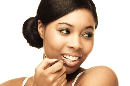 beauty african woman applying her make-up photo