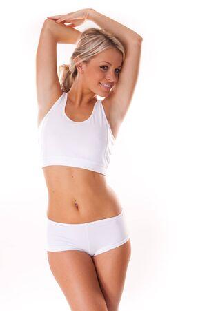 femme en sous vetements: Jeune femme blonde belle v�tements blancs fitness  Banque d'images