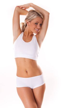 scales thin: Young beautiful blonde woman in white fitness clothing  Stock Photo