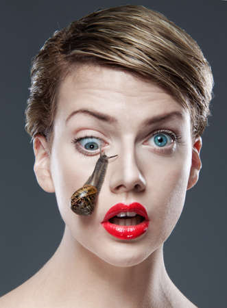 freaked: Woman with snail on face