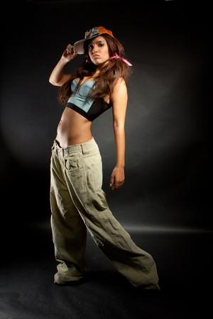 hip hop dancing:  young nice girl dancing modern dances