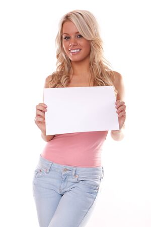 Happy young woman posing with white board. Isolated photo