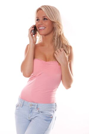 up date: Beautiful girl in pink talking on her smartphone  cell phone  mobile phone