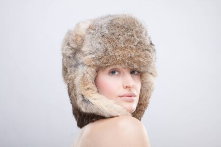 portrait of a beautiful girl in a fur russian hat photo