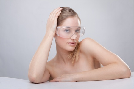 Woman wearing plastic protective goggles. photo
