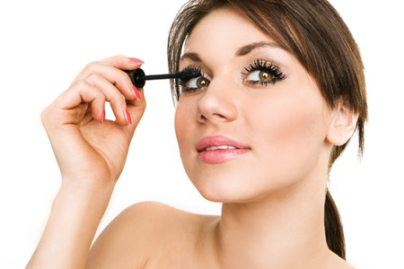 Beautiful woman applying mascara on her eyelashes - isolated on white Stock Photo - 8518025