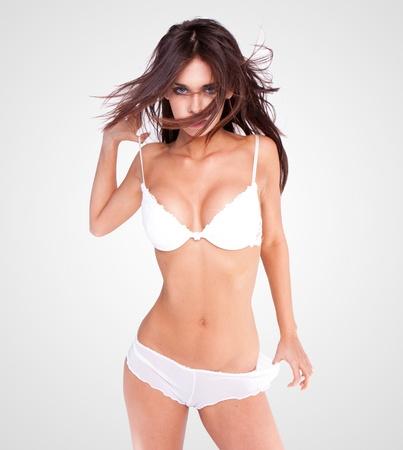 naked sexy woman: sexy brunette wearing white lingerie  Stock Photo