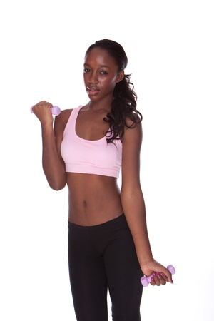 fitness black african woman during exercises on white background  photo
