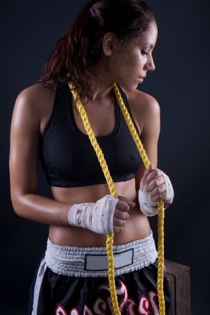Beautiful fitness body passion for exercising. wet brunette holding a rope Stock Photo