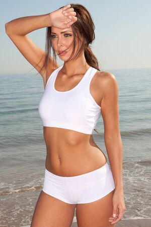 fitness brunette woman exercise on the beach Stock Photo - 9468860