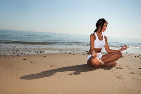 fitness brunette woman exercise on the beach  photo