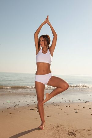 fitness brunette woman exercise on the beach Stock Photo - 9468858