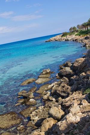 Rocky coast, blue sea and sky. Stock Photo - 9625125