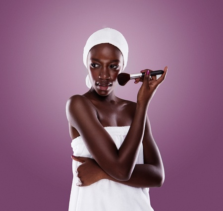 african american spa: black beauty woman after shower cleaning and beauty treatments  Stock Photo