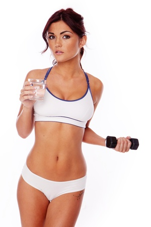 fitness woman on white background drinking water after workout Stock Photo - 11736152
