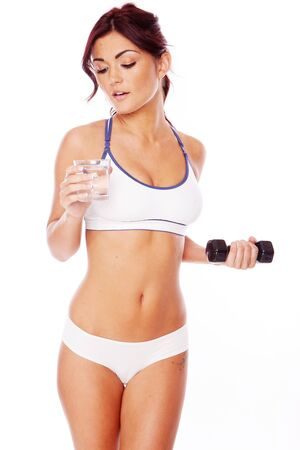 fitness woman on white background drinking water after workout Stock Photo - 11736321