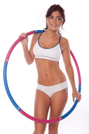women exercise with hoop on white background photo