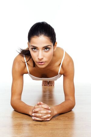 athletic wear: Athletic Girl Doing Stretching Exercises, facing camera outstretched on floor.