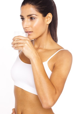 Athlete Drinking Water, an attractive young lady drinks a refreshing glass of water.