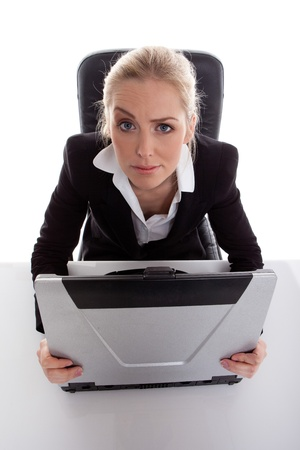 quizzical: Businesswoman Working On Laptop Stock Photo
