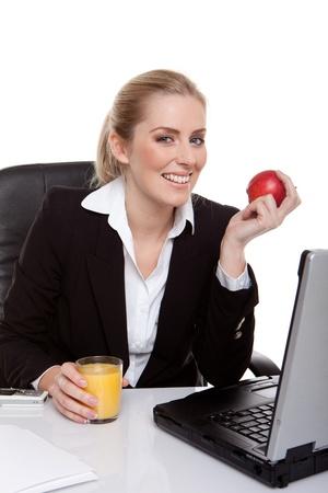apple computer: Businesswoman Working On Laptop Stock Photo
