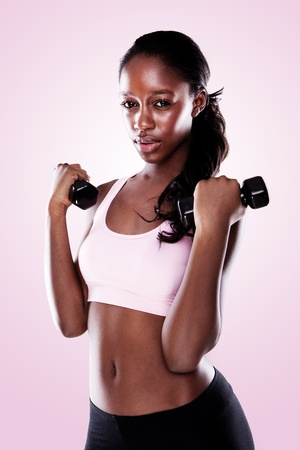 americal: African Americal Woman Lifting Weights, althletic ethnic woman working out with barbells. Stock Photo