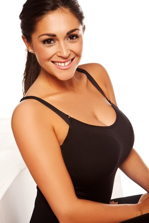 Beautiful smiling happy woman with large breasts in black leotard isolated on white Foto de archivo