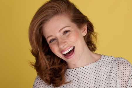 vivacious: Joyful vivacious young redhead woman laughing with her mouth open Stock Photo