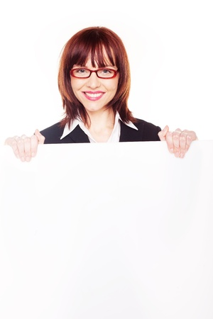 large woman: Smiling redhead businesswoman wearing glasses holding a blank white sign to her chest Stock Photo