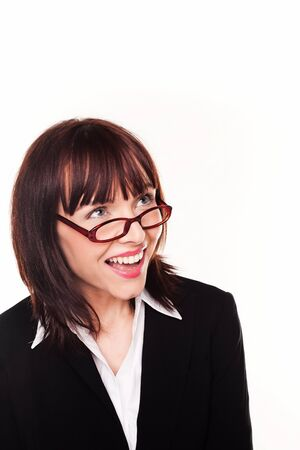 high spirited: Laughing businesswoman looking up over the top of her glasses or spectacles into blank copyspace above her head