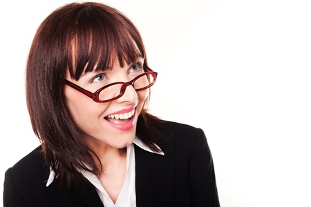 Laughing businesswoman looking up over the top of her glasses into the frame, isolated on white Stock Photo - 12586941