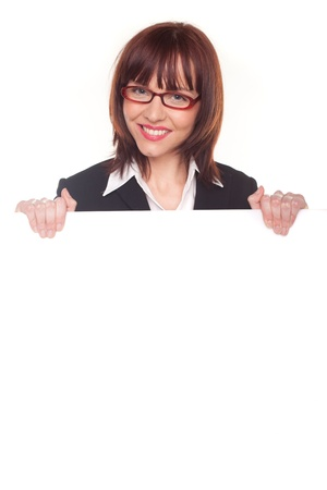 scholarly: Woman in glasses smiling and holding a large blank white sign to her chest