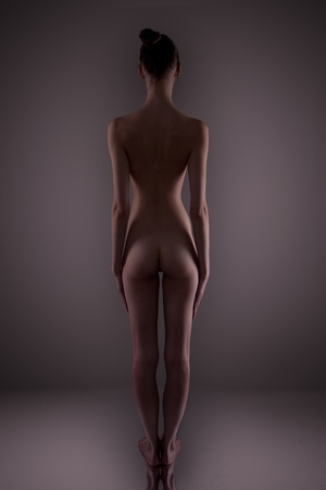 a beautiful young woman showing her naked body Stock Photo - 12586104