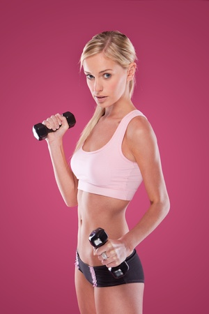 red bra: Blond Fitness Woman on pink background