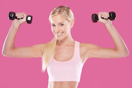 blonde teenager: beautifu happyl blonde fitness model  on pink background Stock Photo